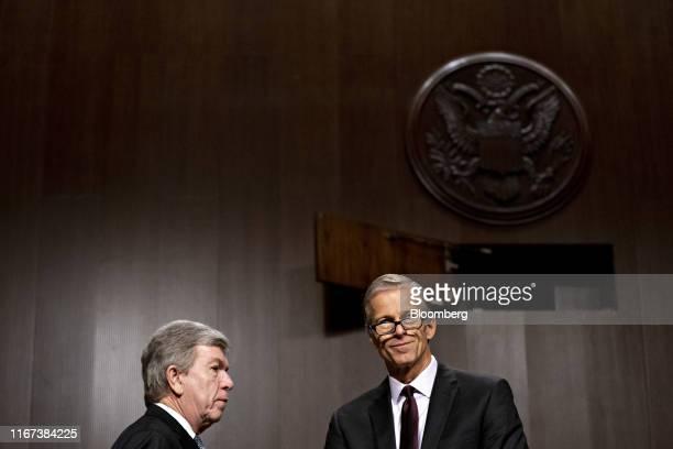 Senator John Thune a Republican from South Dakota right talks to Senator Roy Blunt a Republican from Missouri during a Senate Commerce Science and...