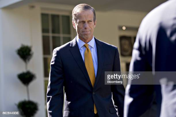 Senator John Thune a Republican from South Dakota walks out of the White House to speak to the media after a Senate Finance Committee meeting with US...