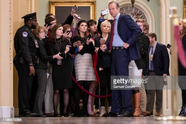 Senator John Thune answers questions from reporters during a recess in the Senate impeachment trial of President Donald Trump on January 27, 2020 in...