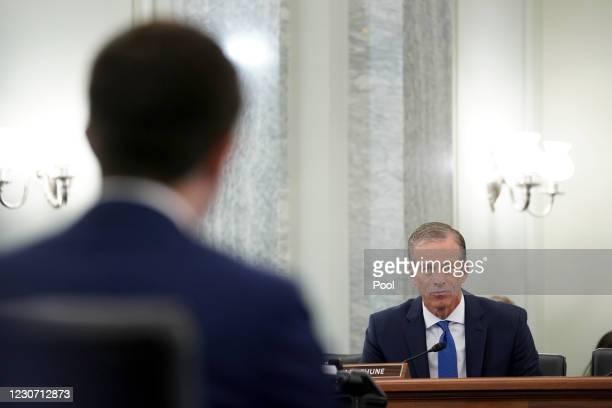 Senator John Thune , listens as Pete Buttigieg, U.S. Secretary of transportation nominee for U.S. President Joe Biden, left, speaks during a Senate...