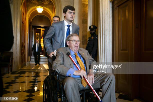 Senator Johnny Isakson a Republican from Georgia departs following a vote on the national emergency declaration in Washington DC US on Thursday March...