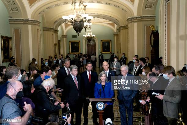 Senator Joni Ernst, a Republican from Iowa, center, speaks during a news conference following Senate Republican policy luncheons at the U.S. Capitol...