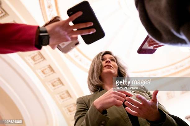 Senator Joni Ernst answers questions from reporters before the Senate impeachment trial of President Donald Trump starts for the day on January 30,...