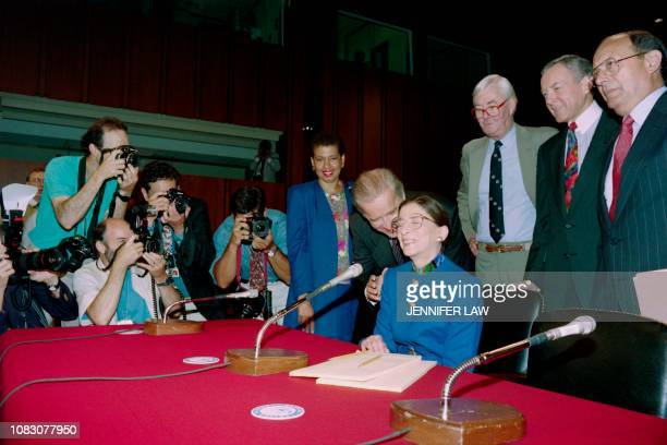 US Senator Joseph Biden chairman of the Senate Judiciary Committee whispers on July 20 1993 to judge Ruth Bader Ginsburg shortly before his committee...