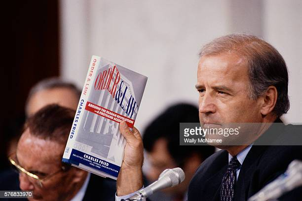 Senator Joseph Biden holds up the book Order and Law by Charles Fried during the Clarence Thomas hearings