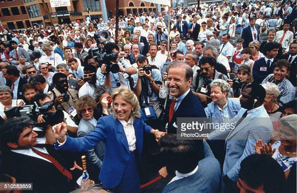 Senator Joseph Biden of Delaware and his wife Jill are surrounded by supporters and representatives of the news media at a rally Wilmington Delaware...