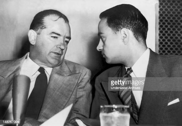 Senator Joseph McCarthy chats with his attorney Roy Cohn during Senate Subcommittee hearings on the Army-McCarthy dispute, Washington DC, 1954.