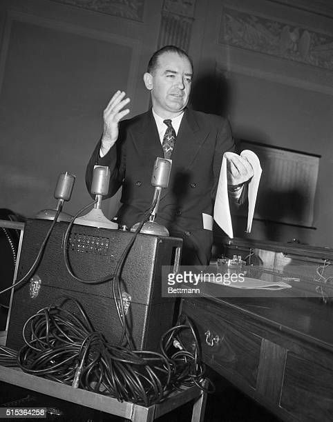 Senator Joseph R. McCarthy stands by the tape recorder that caused all the row at the pre-trial hearing of his slander suit against Senator William...