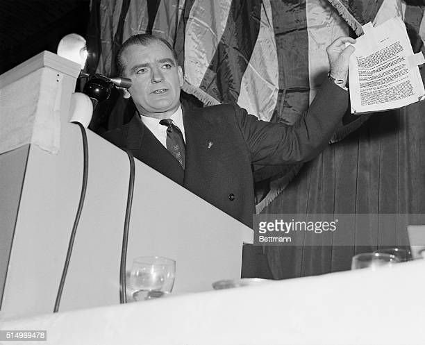 """Senator Joseph R. McCarthy waves a document while delivering a """"report"""" on Democratic presidential candidate Adlai Stevenson. McCarthy addresses a..."""