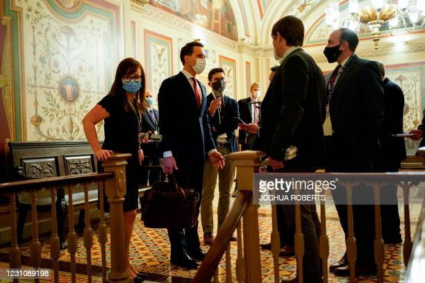 Senator Josh Hawley speaks with a reporter during a break in the impeachment trial of former US President Donald Trump, on charges of inciting the...