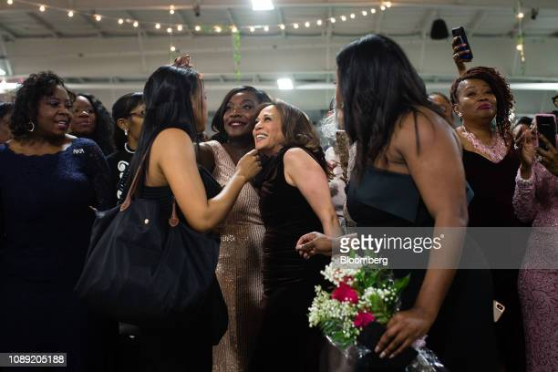 Senator Kamala Harris a Democrat from California center mingles with attendees at the Alpha Kappa Alpha Sorority Inc Annual Pink Ice Gala in Columbia...