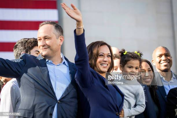 Senator Kamala Harris, a Democrat from California, holds her niece, Amara Ajagu, while standing with her husband, Doug Emhoff, left, during an event...