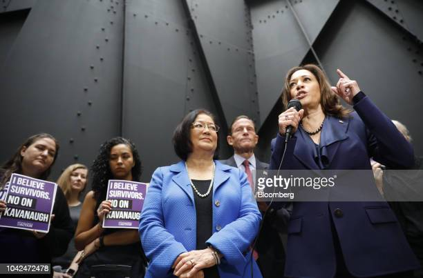 Senator Kamala Harris a Democrat from California right speaks to members of the media after walking out of a markup hearing as Senator Mazie Hirono a...