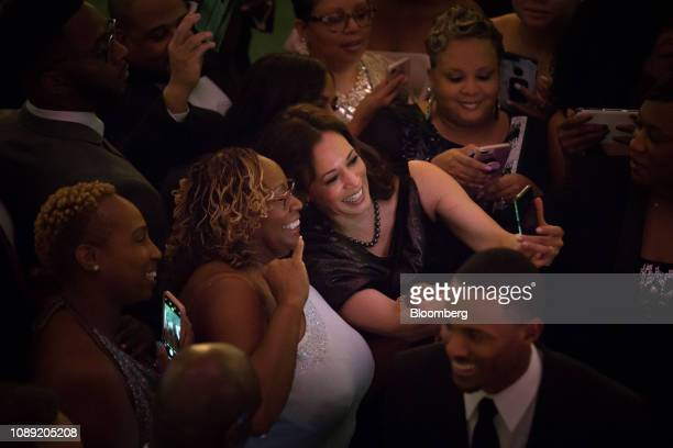 Senator Kamala Harris a Democrat from California uses a mobile device to take a selfie photograph with an attendee during the Alpha Kappa Alpha...