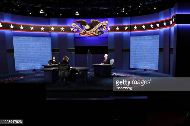 Senator Kamala Harris, Democratic vice presidential nominee, left, speaks as U.S. Vice President Mike Pence, right, listens during the U.S. Vice...