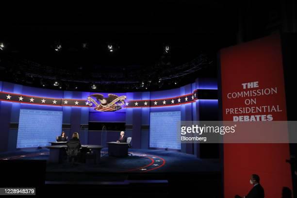 Senator Kamala Harris, Democratic vice presidential nominee, left, speaks as U.S. Vice President Mike Pence, center, listen during the U.S. Vice...