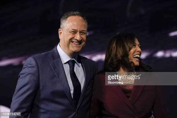 Senator Kamala Harris, Democratic vice presidential nominee, right, and husband Douglas Emhoff smile while standing on stage during the Democratic...