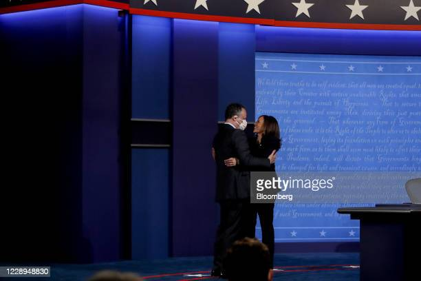 Senator Kamala Harris, Democratic vice presidential nominee, right, and husband Douglas Emhoff embrace during the U.S. Vice presidential debate at...