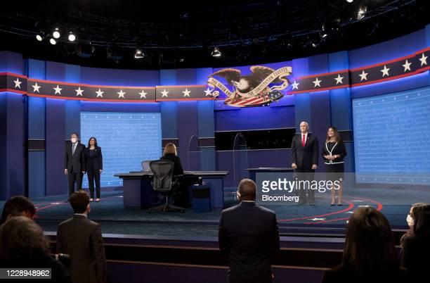 Senator Kamala Harris, Democratic vice presidential nominee, second left, husband Douglas Emhoff, left, U.S. Vice President Mike Pence, second right,...