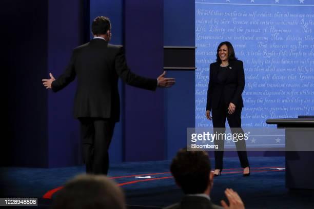 Senator Kamala Harris, Democratic vice presidential nominee, smiles as husband Douglas Emhoff, left, arrives to greet her during the U.S. Vice...