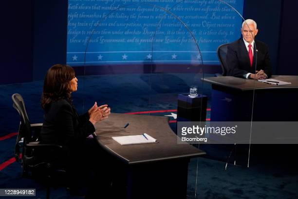 Senator Kamala Harris, Democratic vice presidential nominee, speaks as U.S. Vice President Mike Pence, right, listens during the U.S. Vice...