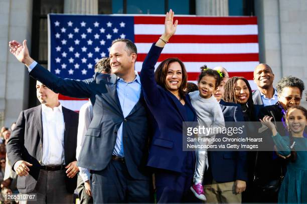 Senator Kamala Harris holds her niece Amara as she and her husband Douglas Emhoff wave to the crowd after making her first presidential campaign...