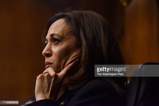 Senator Kamala Harris listens as Attorney General William Barr testifies before the Senate Judiciary Committee at the Dirksen Building on Wednesday,...