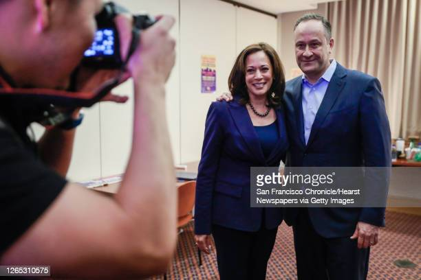 Senator Kamala Harris poses for a photograph with her husband Douglas Emhoff ahead of her presidential campaign rally in of Oakland, California, on...