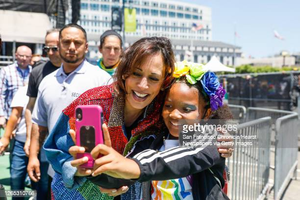 Senator Kamala Harris takes a selfie with a young girl after participating in the annual Pride Parade in San Francisco, California, on Sunday, June...