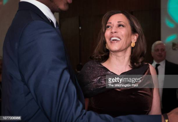 Senator Kamala Harrris laughs with a guest at the Alvin Ailey American Dance Theater's 19th annual Kennedy Center opening night gala to celebrate the...
