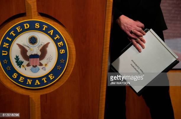 US Senator Kelly Ayotte RNew Hampshire holds a binder as she talks about US President Barack Obama's plan to close the Guantanamo Bay prison during a...