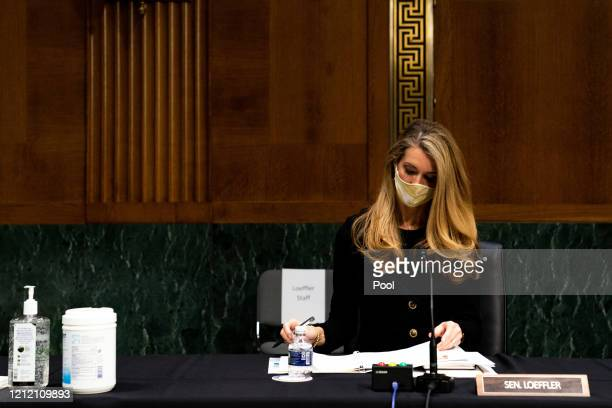Senator Kelly Loeffler RGa looks at her notes during a hearing with the Senate Committee on Health Education Labor and Pensions May 7th 2020 on...