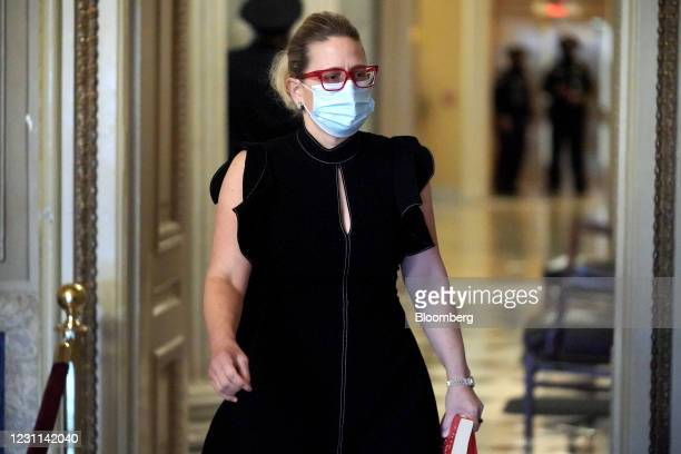 Senator Kyrsten Sinema, a Democrat from Arizona, walks through the U.S., Capitol in Washington, D.C., U.S., on Saturday, Feb. 13, 2021. The Senate...
