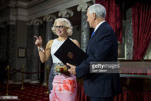Senator Kyrsten Sinema participates in a mock swearing in ceremony with Vice President Mike Pence on Capitol Hill on January 3 2019 in Washington DC