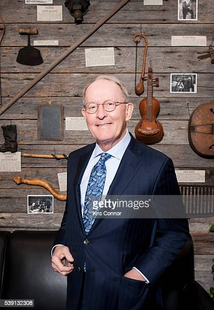 Senator Lamar Alexander poses in front of a display of Tennessee artifacts that line the walls of the lobby of his Washington DC senate office in the...