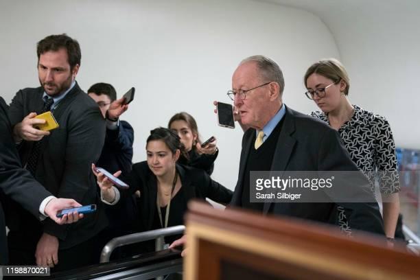 Senator Lamar Alexander walks from the Senate subway to the Senate chamber to cast a vote in the Senate impeachment trial of President Donald Trump...