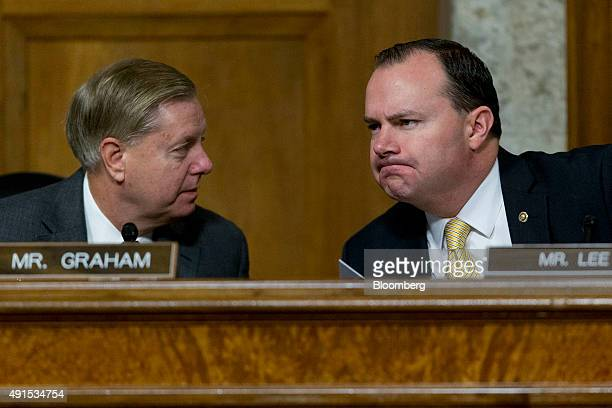Senator Lindsey Graham a Republican from South Carolina and 2016 presidential candidate left talks to Senator Michael Mike Lee a Republican from Utah...