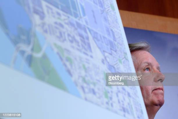 Senator Lindsey Graham a Republican from South Carolina listens behind a map during a news conference on Republican opposition to statehood for the...