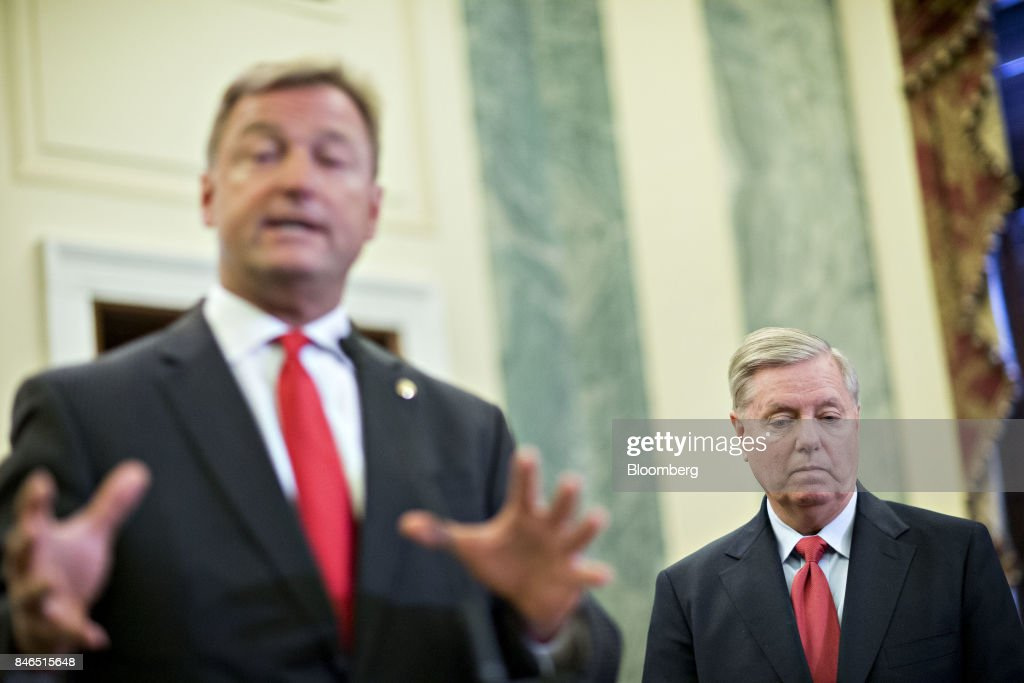 Senator Lindsey Graham, a Republican from South Carolina, right, listens as Senator Dean Heller, a Republican from Nevada, speaks during a news conference to reform health care on Capitol Hill in Washington, D.C., U.S., on Wednesday, Sept. 13, 2017. The Graham-Cassidy-Heller-Johnson (GCHJ) proposal repeals the structure of Obamacare and replaces it with a block grant given annually to states to help individuals pay for health care. Photographer: Andrew Harrer/Bloomberg via Getty Images
