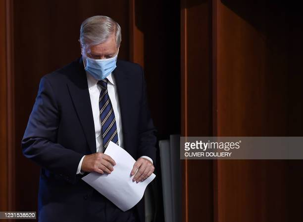 Senator Lindsey Graham arrives to a news conference as the Senate continues to debate the latest Covid-19 relief bill, at the US Capitol in...