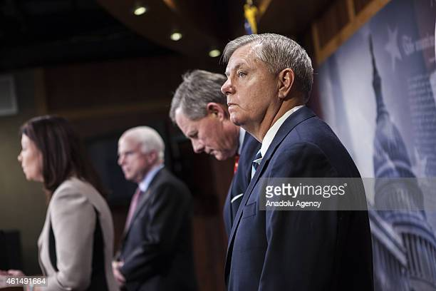 Senator Lindsey Graham attends a press conference with Senator Richard Burr , Senator John McCain , and Senator Kelly Ayotte to announce new proposed...