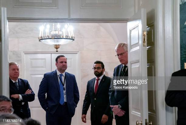 Senator Lindsey Graham listens from outside the Diplomatic Room as US President Donald Trump delivers remarks on the death of ISIS leader Abu Bakr...