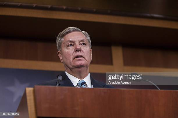 Senator Lindsey Graham speaks at a press conference with Senator Richard Burr , Senator John McCain , and Senator Kelly Ayotte to announce new...
