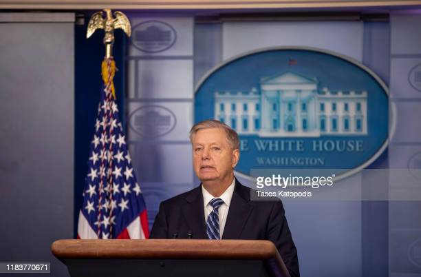 Senator Lindsey Graham speaks to the media after President Donald Trump delivered remarks on the death of ISIS leader Abu Bakr al-Baghdadi, at the...