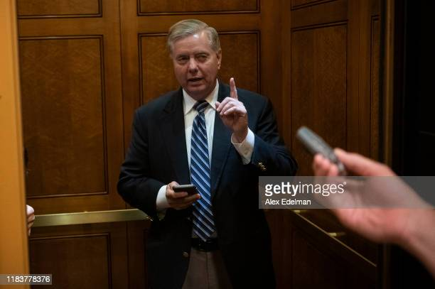Senator Lindsey Graham talks with reporters as he walks through the Senate Subway to vote at the U.S. Capitol on November 21, 2019 in Washington, DC....