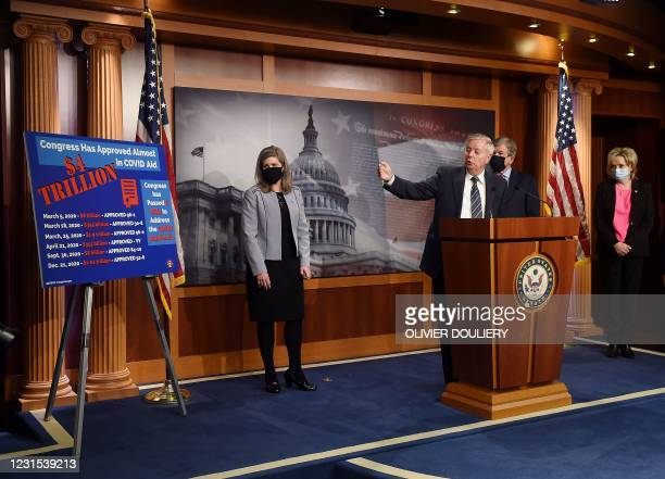 Senator Lindsey Graham , with other Republican senators, speaks during a news conference as the Senate continues to debate the latest Covid-19 relief...