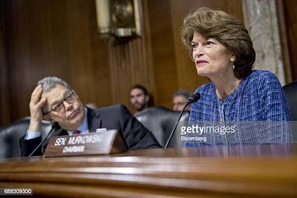 Senator Lisa Murkowski a Republican from Alaska and chairman of the Senate Energy and Natural Resources Committee speaks as Senator Al Franken a...
