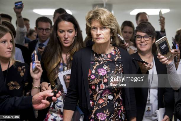 Senator Lisa Murkowski a Republican from Alaska is trailed by members of the media in the basement of the US Capitol in Washington DC US on Tuesday...