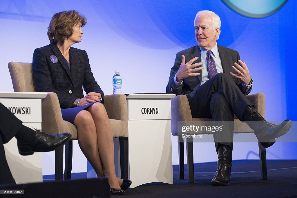 Senator Lisa Murkowski, a Republican from Alaska, left, listens as Senator John Cornyn, a Republican from Texas, speaks during the 2016 IHS CERAWeek conference in Houston, Texas, U.S., on Friday, Feb. 26, 2016. CERAWeek, in its 35th year, will provide new insights and critically-important dialogue with energy industry leaders, experts, government officials and policymakers, and leaders from the technology, financial and industrial communities. Photographer: Matthew Busch/Bloomberg via Getty Images