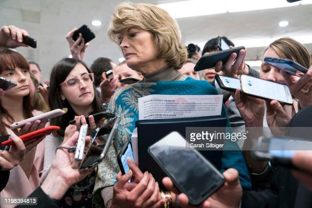 Senator Lisa Murkowski speaks to reporters as she walks to the Senate subway in the U.S. Capitol on February 3, 2020 in Washington, United States....